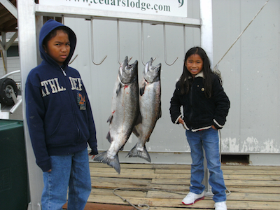 unhappy Hawaiian kids with 2 king salmon